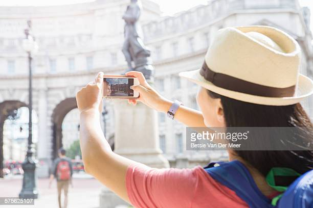 Tourists takes photo of city monument