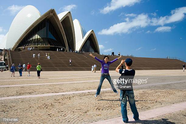 Tourists taking photographs at Sydney Opera House New South Wales Australia