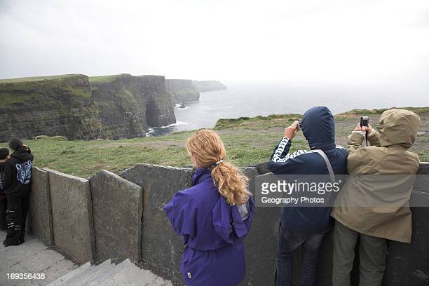 Tourists taking photos Cliffs of Moher Doolin County Clare Ireland