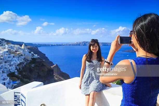 Tourists taking picture in Santorini, Greece