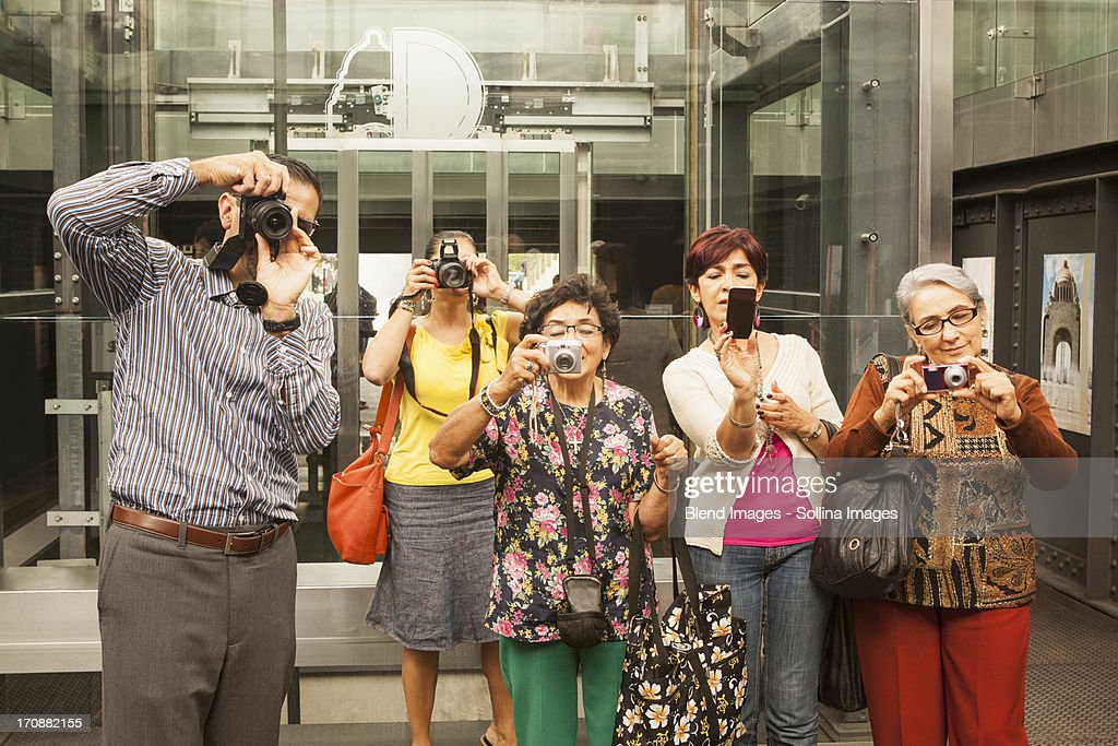Tourists taking pictures in museum