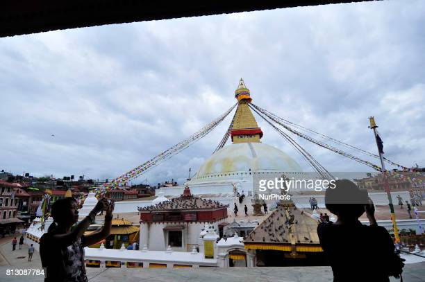 Tourists taking pictures of Boudhanath Stupa at Kathmandu Nepal on Tuesday July 11 2017 Boudhanath Stupa is listed as a UNESCO heritage site in...