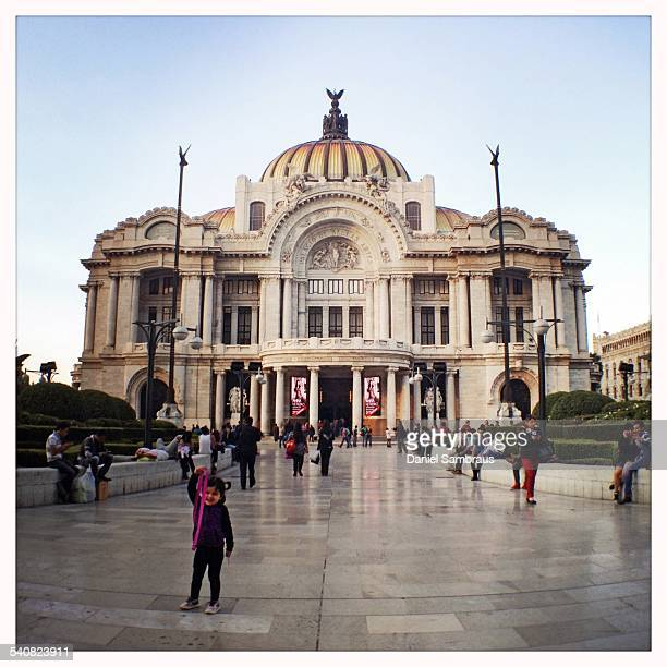 Tourists taking pictures outside the neoclassical Palacio de Bellas Artes Mexico City's most important cultural centre