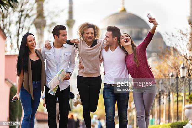 Tourists taking selfies in front of Blue Mosque in Istanbul