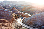 Tourists took the bus to see the beautiful scenery of Danxia landform  in the National Geopark of Zhangye, Gansu, China.