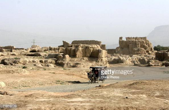 Tourists tour the Ancient City of Gaochang which is undergoing renovation by a carriage September 16 2006 in Turfan of Xinjiang Uygur Autonomous...