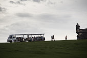 Tourists travel in a people mover near the Castillo San Felipe del Morro in San Juan Puerto Rico on Sunday May 1 2016 Puerto Rico will default on a...