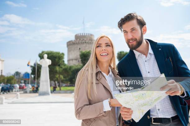 Tourists traveling and holding a map
