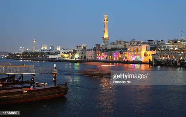 Tourists use abras and water taxi's to to cross Dubai Creek on April 29 2014 in Dubai United Arab Emirates