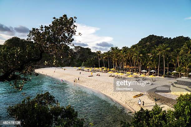 Tourists use Puka Shell Beach at the ShangriLa Boracay Resort Spa Philippines in Boracay the Philippines on Tuesday July 28 2015 The Philippines an...