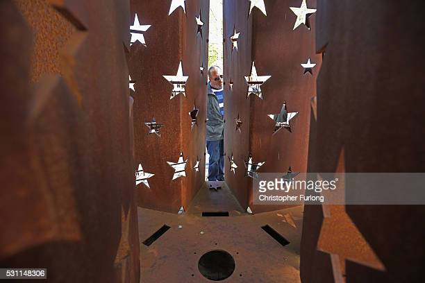 Tourists view and photograph a commemorative sculpture at the dock where the 1985 European Schengen Agreement was signed on May 11 2016 in Schengen...