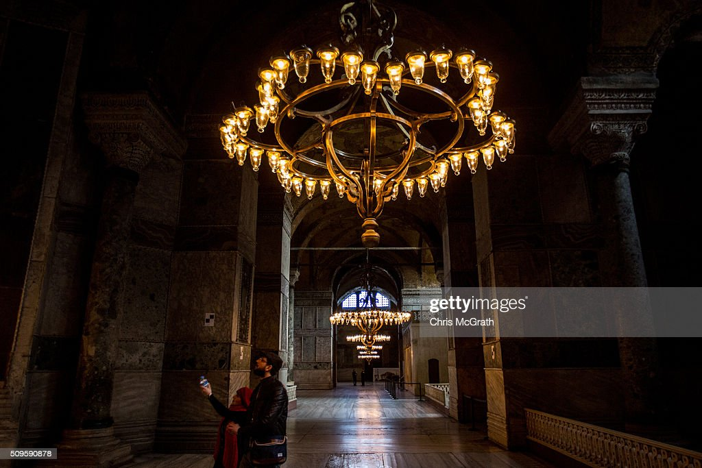Tourists view the interior of the Hagia Sophia Museum on February 11, 2016 in Istanbul, Turkey. The Hagia Sophia (Ayasofya) Museum is one of the most visited tourist attractions in Turkey, with more than 3 million visitors per year. Constructed in 537 the museum originally served as an Orthodox Cathedral, later a Roman Catholic church and was converted into a mosque when Constantinople was conquered by the Ottoman Turks in 1453. In 1935 it was opened as a museum by the Republic of Turkey. The museum is currently undergoing restoration on various parts of the interior.