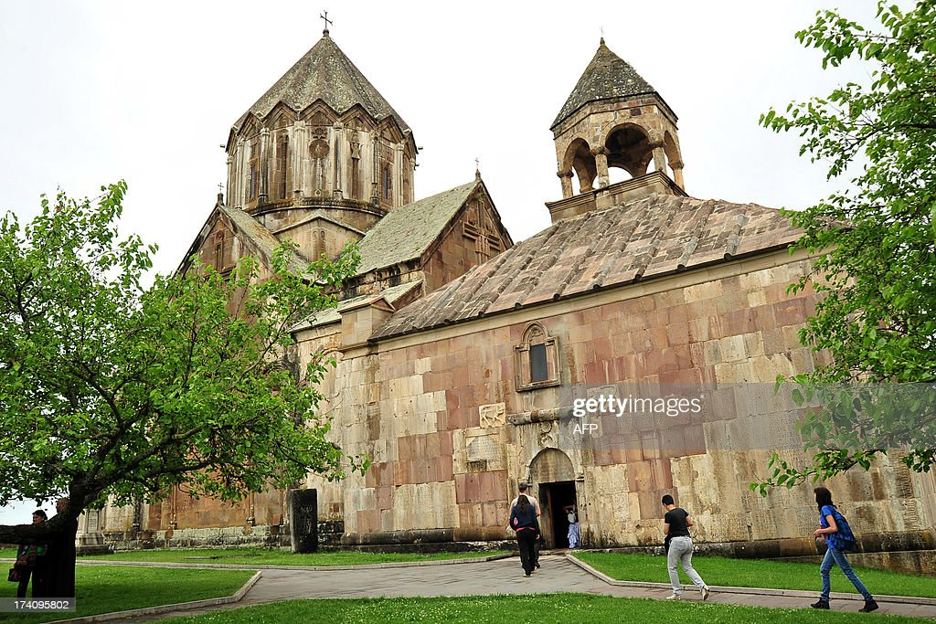 Tourists visit 13th century's St.John Cathedral in Gandzasar monastery about 45 km from city of Stepanakert in Armenian-controlled Azerbaijani region of Nagorny Karabakh on June 27, 2013. A growing number of foreign tourists are heading to the breakaway territory -- which is not recognised by any state -- and say they are seeing a different side to its war-scarred image. Wandering around the region's largest town Stepanakert as part of a tour group whose members come from places ranging from Turin to Taiwan, French chemist Jordan Nahoum said that while he knew all about Nagorny Karabakh's bloody past, he was surprised by what he found.