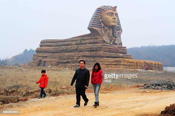 Tourists visit a fullsize replica of the Great Sphinx on March 14 2015 in Chuzhou Anhui province of China The replica has been built as part of the...