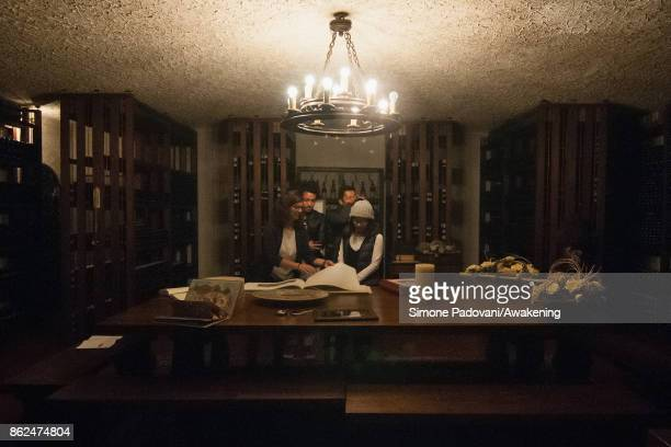 Tourists visit a winery of Barolo on October 17 2017 in the Barolo region Italy Because of the high summer temperatures Barolo's harvest has been...