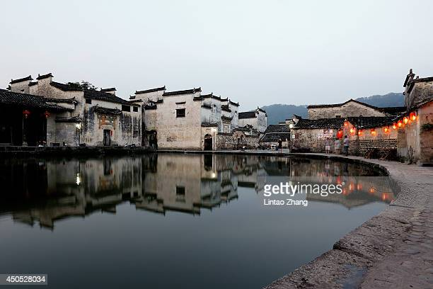 Tourists visit an ancient house on June 12 2014 at Hongcun Village China Hongcun Village located in the eastern province of Anhui is an ancient...