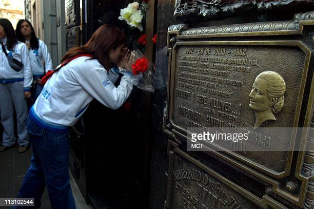 Tourists visit Evita's family crypt in the Recoleta cemetery in Buenos Aires September 16 2004 Construction on a mausoleum for Evita and Juan Peron...