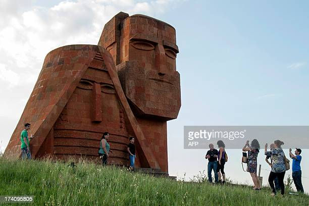 Tourists visit Grandmother and Granfather monument outside city of Stepanakert in Armeniancontrolled Azerbaijani region of Nagorny Karabakh on June...