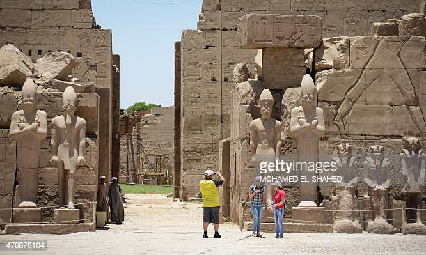 Tourists visit Karnak temple in Luxor a town 700 kilometres south of the Egyptian capital Cairo on June 11 2015 The ancient temple was open as usual...
