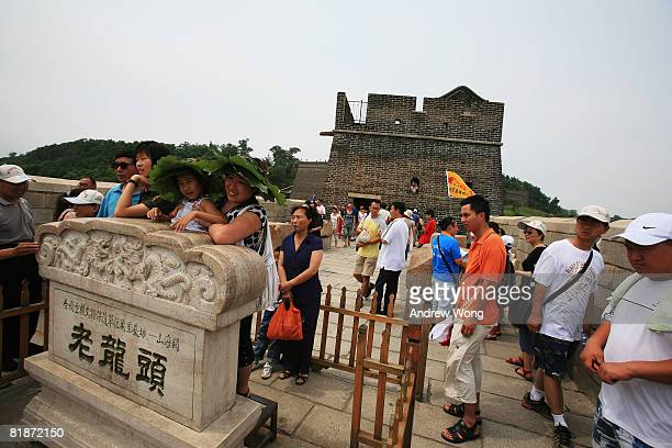 Tourists visit Laolongtou or Old Dragon's Head section of the Great Wall on July 9 2009 in Qinhuangdao Hebei Province of China Old Dragon's Head is...