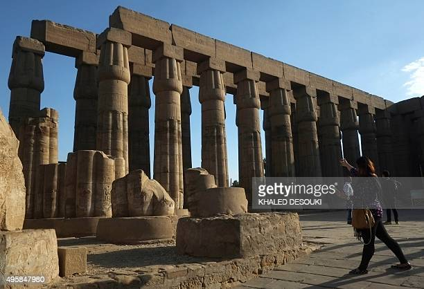 Tourists visit Luxor temple on the East Bank of Egypt's ancient city of Luxor on November 5 2015 Britain probed security at Egypt's Red Sea resort of...