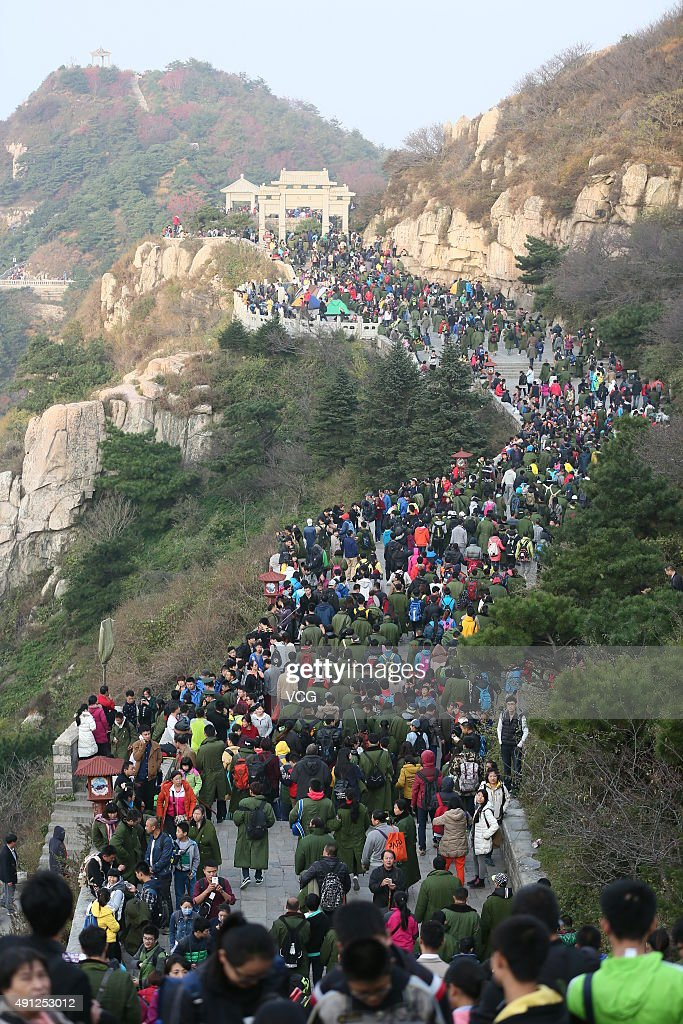 Tourists visit Mount Tai during National Day holiday on October 4 2015 in Taian Shandong Province of China Many scenic spots in China have welcomed...