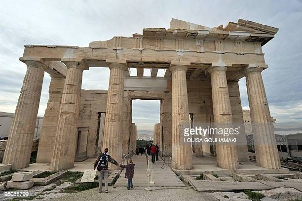 Tourists visit Propylaia the ancient Acropolis gateway following completed restoration works on December 22 2009 Workers have removed scaffolding...