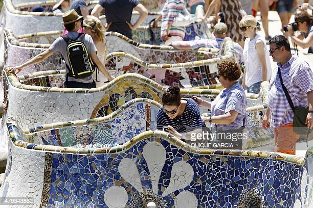 Tourists visit Spanish architect Gaudi's Park Guell in Barcelona on June 28 2015 Tourists generated 14% of municipal GDP but these 27 million...