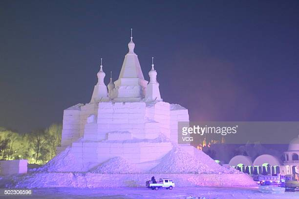Tourists visit the 17th Harbin Ice And Snow World during its test run on December 22 2015 in Harbin China The event will run from December 25 2015 to...
