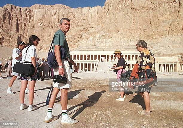 US tourists visit the 4500 yearold Pharaonic temple of Hatshepsut in Luxor's Valley of the Queens18 November 24 hours after the massacre of 58...