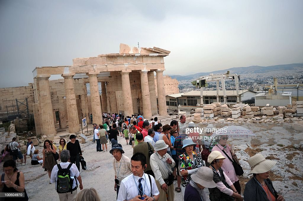 Tourists visit the Acropolis archeological site in Athens on May 8, 2010. An imminent EU-IMF loan rescue failed to dispel Greek gloom on May 8 over giant budget cuts which could spell an uncertain economic future as the country's main labour union warned of fresh protests. The launch of an unprecedented bailout worth 110 billion euros (140 billion US dollars) badly needed by debt-hit Athens could be days away but the mood is dominated by the week's deadly riots and fear of the coming austerity storm.