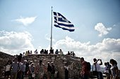 Tourists visit the Acropolis in Athens on June 30 2015 Greece appeared set Tuesday to default on a key IMF repayment fanning fears of a chaotic...
