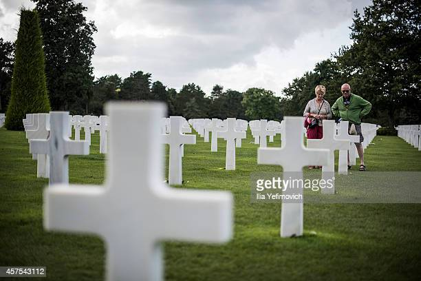 Tourists visit the American military cemetery on August 11 2014 in Normandy France As the world celebrats this year a 70th anniversary of the...