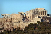 Tourists visit the ancient Acropolis in Athens on August 7 2013 AFP PHOTO / LOUISA GOULIAMAKI