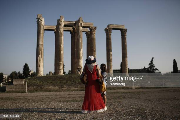 Tourists visit the ancient Greek temple of Olympian Zeus in Athens Greece on Wednesday June 28 2017 The change in sentiment toward Greece the...