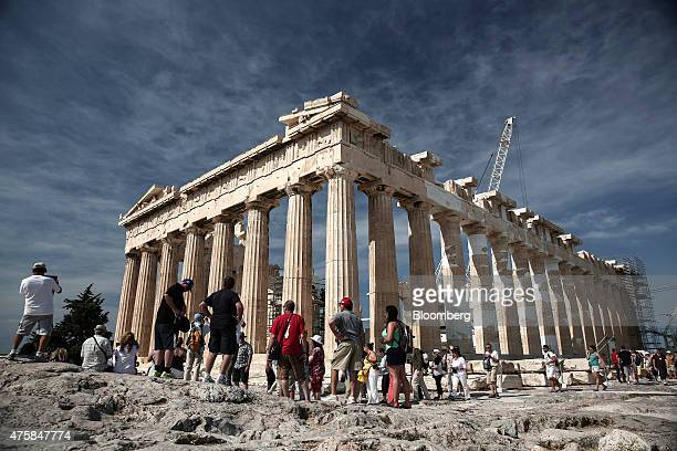 Tourists visit the ancient ruins of the Parthenon temple on Acropolis hill in Athens Greece on Thursday June 4 2015 Greek Prime Minister Alexis...