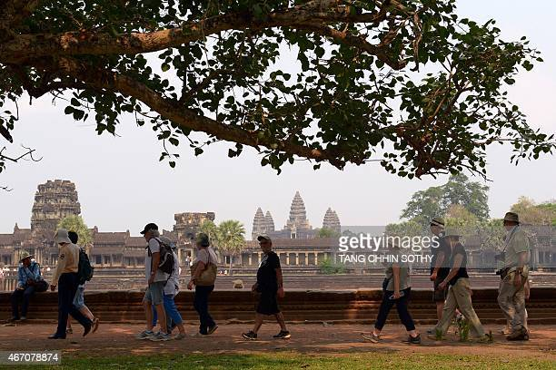 Tourists visit the Angkor Wat temple in Siem Reap province on March 20 2015 US First Lady Michelle Obama flew into Cambodia at the tourist hub of...