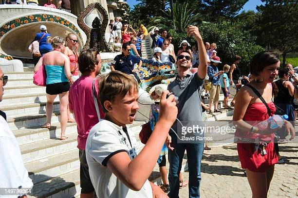Tourists visit the Antoni Gaudi's Parc Guell on August 4 2012 in Barcelona Spain Tourism is the largest contributor to the welfare of Spain's economy...