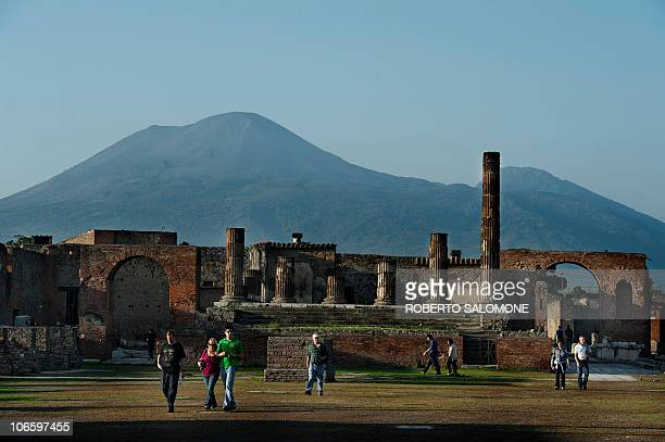 Tourists visit the archaeological site of Pompeii where the Gladiator domus a house of Roman age collapsed on November 6 2010 The city of roman age...