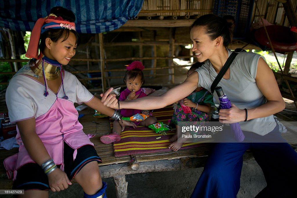 Tourists visit the Baan Tong Luang Hiill tribe village on September 4, 2012. The theme park is a fabricated village containing over 6 separate ethnic Thai Hill Tribes. Some of the ethnic tribes include the Lahu, Hmong, White Karen, Long necked Karen, Yao, and Akha. The village opened in 2005 attempting to preserve the old traditions of the ethnic Hill Tribe, while providing an income for them. Visitors must pay an entry fee of 500 Thai that or $16. Life for many of Thailand's Hill Tribe population can be difficult since it can be hard for them to make a living. Their language, costume and culture are different along with the frequent legal problems over Thai citizenship. Hill tribe is a term used in Thailand for all of the various tribal peoples who migrated from Tibet, or elsewhere in China over the past few centuries.