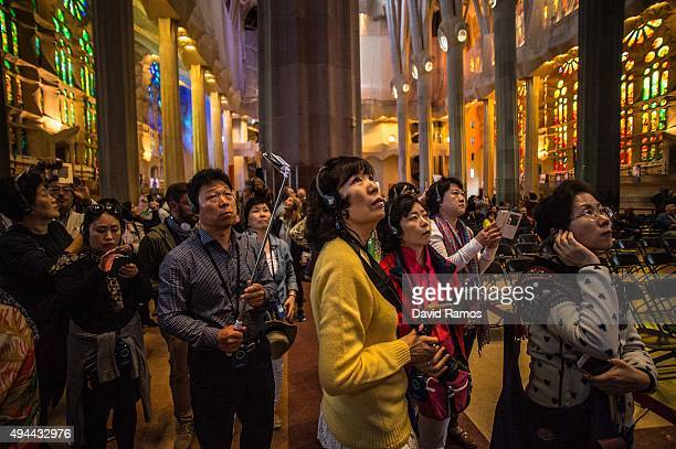 Tourists visit the Basilica of 'La Sagrada Familia' on October 26 2015 in Barcelona Spain 'La Sagrada Familia' Foundation announced on October 21...