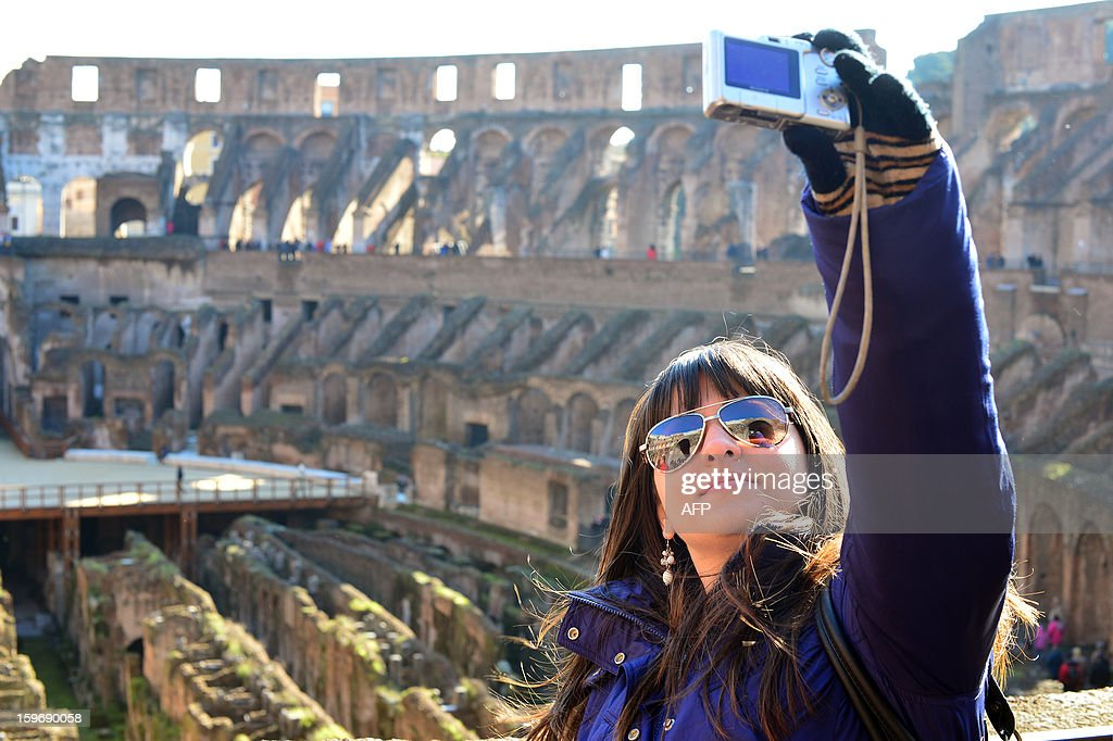 Tourists visit the Colosseum on January 18, 2013 in Rome. Traces of decorations in blue, red and greenwere found in a corridor currently closed to the public while archaeologists were working to restore an area between the second and third floor of the Colosseum, which has fallen into disrepair in recent years.