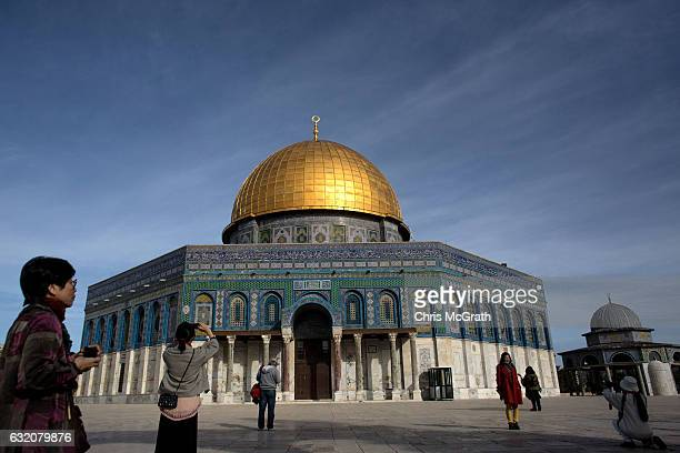 Tourists visit the Dome of the Rock at the AlAqsa mosque compound in the Old City on January 17 2017 in Jerusalem Israel 70 countries attended the...