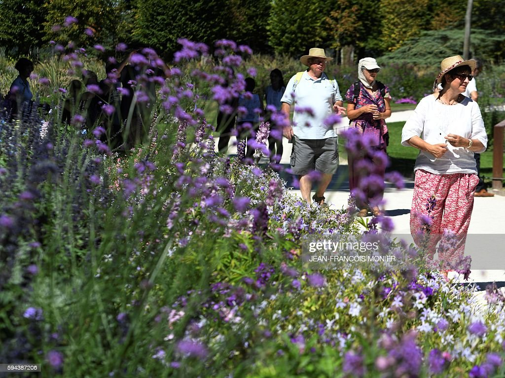Tourists visit the garden of Chaumont Castle during sunny weather on August 23 in ChaumontsurLoire central France / AFP / JEANFRANCOIS MONIER
