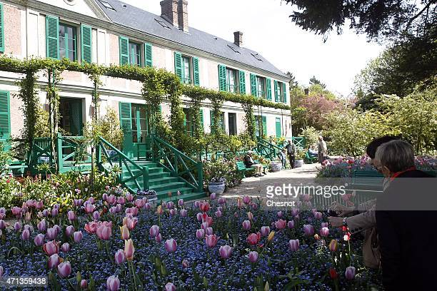 Tourists visit the garden of Claude Monet on Monday 27 2015 in Giverny France The famous French impressionist painter Claude Monet lived in his house...