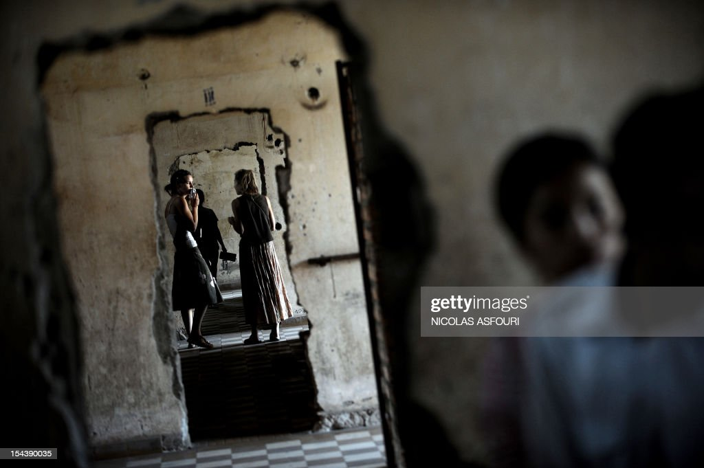 Tourists visit the genocide museum at Tuol Sleng, the former prison S-21 used by the Khmer Rouge to imprison and torture thousands of Cambodians during the 1970s, in Phnom Penh on February 10, 2009. Cambodia's UN-backed genocide tribunal will on February 17, 2009 formally open the long-awaited trial of the Khmer Rouge regime's former Toul Sleng prison chief, Kaing Guek Eav, better known as Duch, who is the first of the five leaders detained by the tribunal. Duch, now 66, faces charges of crimes against humanity, war crimes, torture and pre-meditated murder for his role in running S-21, the Khmer Rouge's notorious main prison, during the 1975-1979 regime.