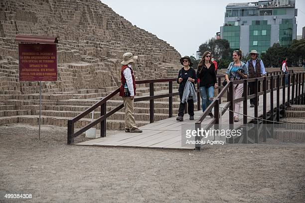 Tourists visit the Huaca Pucllana archaeological site in Lima Peru on November 30 2015 The team of archaeologists from the Huaca Pucllana discovered...