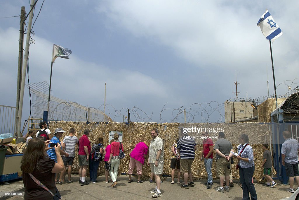 Tourists visit the Israel-Lebanon border crossing in Rosh Hanikra, northern Israel, on May 6, 2013.
