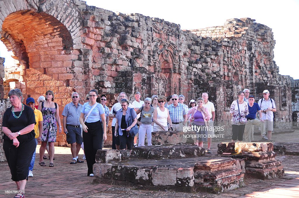 Tourists visit the Jesuitical ruins in Trinidad, Paraguay, on January 27, 2013. The finding of hexagonal tiles from the floor of a large Jesuitical temple built by Guarani indians in the XVII century, rekindled an ambicious project of rediscovering the ruins of the paradise lost when the Jesuits were expelled from the country in 1767.