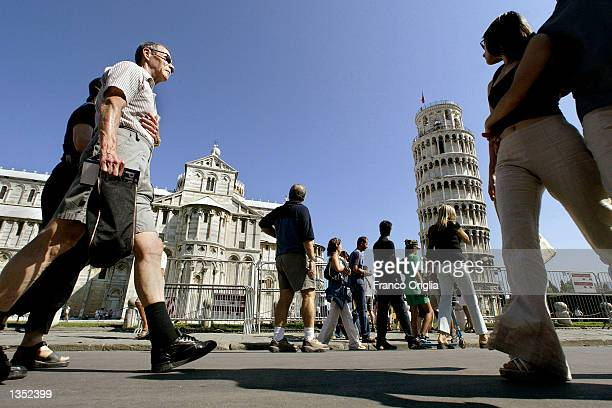 Tourists visit the Leaning Tower of Pisa and the Cathedral in the 'Square of Miracle' August 24 2002 in Pisa Italy The tower reopened in December...